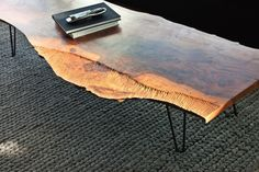 rugged wooden table. #dwell - wonder if my trees in the yard would make a cute table....