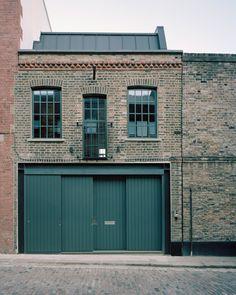 Tasou Associates turns abandoned London warehouse into office Building Facade, Building Exterior, Building Ideas, Car Part Furniture, Automotive Furniture, Automotive Decor, Warehouse Apartment, Abandoned Warehouse, Warehouse Design
