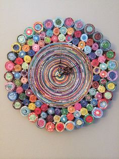 This unique clock is a favorite of mine! It is made from recycled magazines and measures 12 inches in diameter. I hand select each piece to