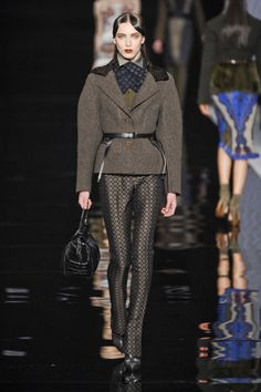 Etro Fall 2012 - middle part hair and masculine features with the large necktie, trench-style blazer, and fitted pants almost like extended breeches