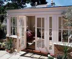 Heavy woodwork on the corners  of this orangery