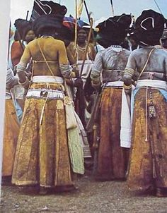 Xhosa women wearing their headdresses, long skirts and their leather purses