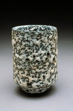 Lucie Rie fired her pieces once, instead of one bisque firing and one glaze firing. One of the reasons for this was during the war, she had to hand-carry her greenware on the underground to a kiln on the other side of London, and wanted to minimize the number of trips. She applied glaze directly to the unfired greenware.