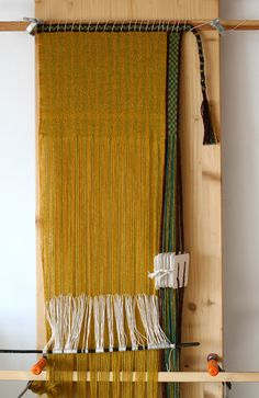 Simple warp weighted loom set-up with a tablet woven starting border and side border. Marijke van Epen