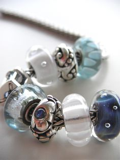 Beautiful photo of beads with great lighting. This is not my Trollbead design, but I like it. I especially like the carved flowers.