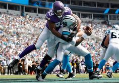 The Vikings Danielle Hunters (99), sacks Cam Newton (1) in the end zone for a safety in the first quarter of an NFL football game Sunday, Sept. 25, 2016, in Charlotte, N.C. (Carlos Gonzalez/Star Tribune via AP) ] CARLOS GONZALEZ cgonzalez@startribune.com - September 25, 2016, Charlotte, NC, Bank of America Stadium, NFL, Minnesota Vikings vs. Carolina Panthers