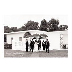 #tbt to Price & Ryan's wedding in 2013!  It feels like deja vu today with the rain still coming down here in Charleston! @pricesigal #gastoncountryclub #weddings #rain #rainywedding #umbrellas #jenningskingphotography