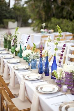 Vineyard Wedding Reception with colorful glass bottle centerpieces. Bottle Centerpieces, Wedding Centerpieces, Wedding Table, Diy Wedding, Wedding Reception, Wedding Decorations, Table Decorations, Wedding Ideas, Centerpiece Ideas