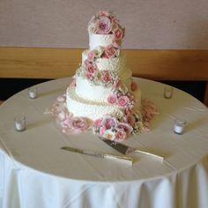 Cascading flowers on scroll design wedding cake