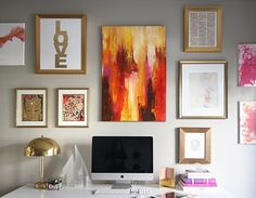cool gallery wall above deal. like the gold frames. i want that LOVE print...and kids finger paintings on right.