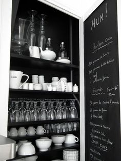 These shallow shelves are a wonderful idea - can fit in so much more - and I  ♥ the blackboard on the inside of the cabinet