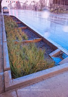 A stormwater curb extension retrofit to an existing street on a slope (weirs).  Stormwater management facilities like this one are are also ...