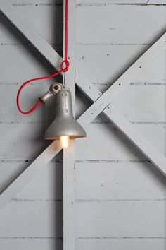 Rejuvenation Industrial: Industrial light with playful red cord