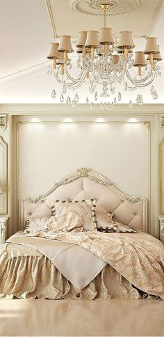 This bed is slightly recessed into the wall, creating elegant storage on either side.  The chandelier is the icing on the cake!