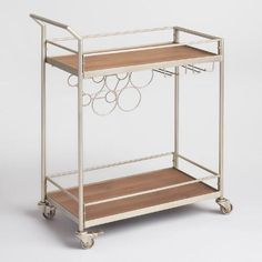 Complete your home bar setup with our sleek and stylish cart, crafted of wood and metal in a champagne finish. With a built-in wine rack, this four-wheel cart is simple to assemble and can be stocked with spirits, mixers and other bar essentials. Great to have for parties, it's easily rolled from room to room.