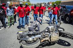 Picture of a Dogs of War member after being pulled from his motorcycle in Senekal, while driving past an angry mob of EFF members at the bail hearing for two suspects in the brutal farm murder of Brendin Horner Military Veterans, Bikers, Motorcycle, War, Dogs, Motorcycles, Pet Dogs, Motorbikes, Dog