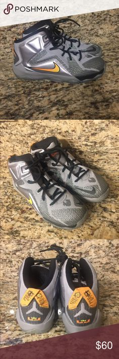 Boys LeBron XII Nike's Perfect condition. Were only tried on. Boys youth size 2. Nike Shoes Sneakers