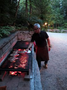 Geoffrey at the grill. I had this Argentine grill fashioned from steel- the long steel Outdoor Barbeque, Outdoor Cooking Area, Outdoor Kitchen Patio, Outdoor Oven, Outdoor Kitchen Design, Outdoor Fire, Barbecue Grill, Fire Pit Bbq, Fire Pit Backyard