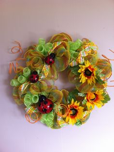 Wreaths by Merry Mary  Lady bugs and sunflower deco mesh wreath.