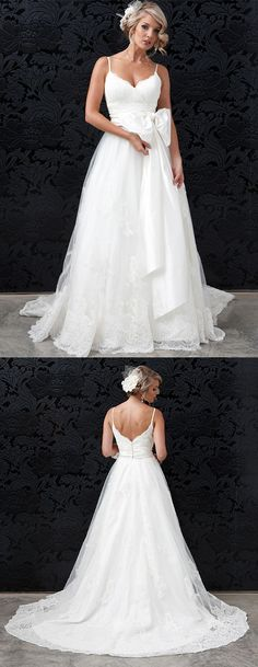 We heart this ivory lace wedding dress with sweetheart neckline and dupion silk waist sash tied in an every gorgeous bow.
