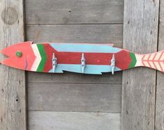 Unique hand painted wooden fish with three attached boat cleat hangers. Whimsical yet practical nautical decor. Art with a purpose.
