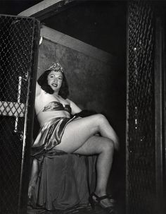 Transvestite in a Police Van (1941) by Weegee the Famous.