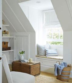 The former bedroom was converted into a casual den by swapping out an affixed desk for a cushion-topped window seat that has a drawer underneath. The owner upped the cottage quotient with charming built-ins that have clever storage.