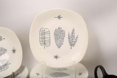 A 1950s MIDWINTER NATURE STUDY DINNER SERVICE, designed by Terrence Conran, to include, teapot, coffee pot, milk jug, two lidded tureens, cake stand, gravy boat, cups and saucers, soup bowl and under plates, serving platter, dinner plates, side plates, desert bowls, etc (Qty).