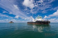 Transport of coal in Kalimantan Indonesia - mining photography by DOMINIK