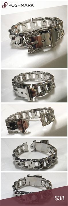 Chain Link Crystal Buckle Cuff Bracelet Beautiful silver-plated structured chainlink cuff with an Austrian Crystal adorned buckle closure and hinged bottom. PERFECT HOLIDAY GIFT Pairs great with a watch and other cuffs or bangles. Jewelry Bracelets
