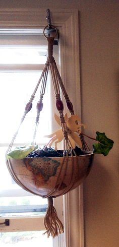 Gifted half globe made into a planter.
