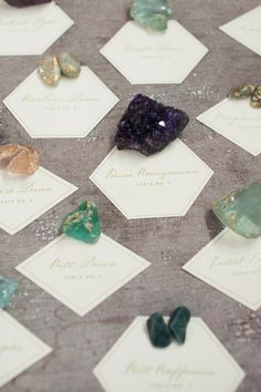 A stylish way of using precious stones for the table plan. These can also double up as pretty favours.