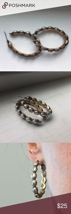 🎄pretty Lucky Brand hoop earrings Solid feeling with pretty etched design along edge and unusual shift from interior golden color to exterior pearly silver- some flair to these elongated vintage styled hoops☀️ ntnw Lucky Brand Jewelry Earrings