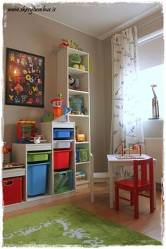 Shared bedroom for a toddler and a infant.  Gray walls, and pops of colors all around...