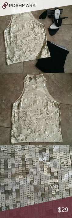 WHITE HOUSE BLACK MARKET SEQUINS TANK Gold sequins funnel neck tank top. Perfect with shorts and heels or black dress pants. 3 small button closure on back of neck. 78% silk, 19% nylon and 3% spandex. Hand wash. No rips or stains. Smoke free home. White House Black Market Tops Tank Tops