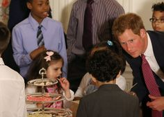Prince Harry chatted with children at First Lady Michelle Obama's event honoring military families.