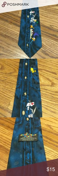 Looney Tunes Mania Men's Tie Looney Tunes men's tie. Made to look like the characters are peeking out of the button placket. Road Runner, Taz, Daffy Duck, Bugs Bunny, Sylvester and Tweety all make an appearance. 100% silk, hand made  🌟Smoke free home 🌟No trades 🌟111 Looney Tunes Accessories Ties