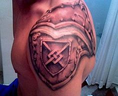 Shoulder armor tattoo that would allow for a possible Family Crest, Military unit crest or shoulder patch or other emblem. If you could find the right artist that has mastered line work as well as shadow and light technique, this could be awesome!