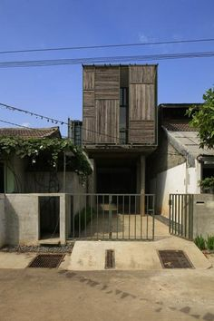 Wisnu & Ndari House / djuhara + djuhara,An Indonesian Home With A Reclaimed Wood Facade Houses Architecture, Container Architecture, Residential Architecture, Architecture Details, Interior Architecture, Facade Design, House Design, Narrow House, Steel House