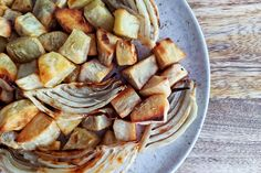 Roasted Fennel & White Sweet Potatoes | The Open Cookbook. Great tip to soak the potatoes before using - I'll try that!