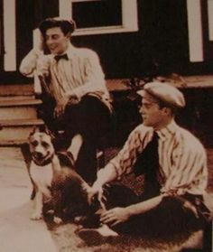 [B/w photo of Buster Keaton, Luke the Dog, and Al St. John, lounging around outside]  cakebythelakewrites:    A smile…
