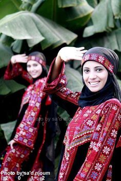 Palestinian Embroidery …these two ladies are dancing the Dabheh.  Beautiful ladies.