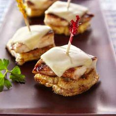 Melted cheese tops honey and cinnamon-flavored chicken in these grilled appetizers.