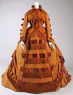 Day Dress dated 1867-1871. Designed by Depret (French). Finely crafted of pumpkin orange silk. / From #Victorian Fashion through the Seasons-Autumn on AuthorAngelaBell.com