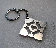 portal companion cube keychain. yep. want.