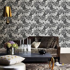 A large-scale pattern and black on charcoal color scheme take the frill out of florals. Hand sketched detail and a distressed texture print create dimension. Fanciful is a non woven, unpasted wallpaper.
