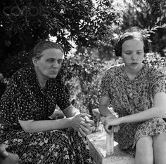 "July 23, 1945 : Frau Margareta Himmler, widow of Heinrich Himmler, Nazi Gestapo Chief, and her daughter, Gudrun, are shown at the allied detention camp near Rome, where they were interviewed recently for the first time. Frau Himmler defended the actions of her world-despised husband with the laconic statement, ""Nobody loves a policeman."""