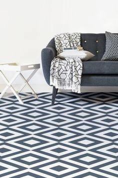 Steal the show with this striking geometric flooring design. A stunning rhythmic pattern of a sophisticated navy blue and pure white. This vinyl flooring design is simply mesmerising, and would look beautiful in any home.