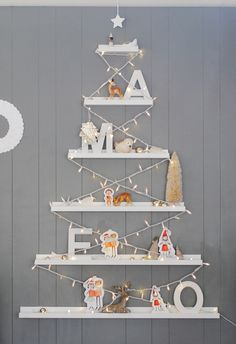 String up some lights on a set of RIBBA ledges to create an easy Christmas tree on your wall!