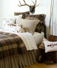 Deerfield Duvet Cover by Taylor Linens. $297.00. Design Elements: Plaid. Primary Color: Green. Quick ShipMultiple SizesThe Deerfield Duvet Cover is perfect for an outdoors themed boy's room. This boy's bedding collection features a masculine plaid of browns, creams and sages with corded piping and horn button closures. Complete your boy's bedding set with the coordinating accessories.  Offering exquisite linens since 1922 when the founder started importing damask linens from I...